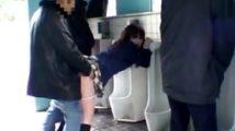 外から丸見えの公衆便所でパンティを摺り下ろされ便器にしがみつきながらバックから犯されイラマ調教される女子校生